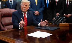 US President Donald Trump takes questions after signing S. 153, The Supporting Veterans in STEM Careers Act, in the Oval Office of the White House in Washington, DC, on February 11, 2020. (Photo by JIM WATSON / AFP)