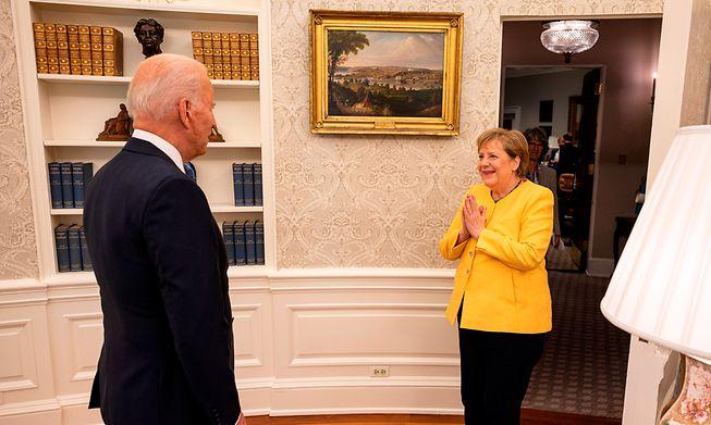 US President Joe Biden welcomes German Chancellor Angela Merkel to the Oval Office of the White House on Thursday.