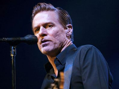 Canadian musician Bryan Adams performs during a concert in Beirut in this December 14, 2010 file photograph. Adams has become a father for the first time at the age of 51, People magazine reported on May 5, 2011. REUTERS/Cynthia Karam/Files   (LEBANON - Tags: ENTERTAINMENT)