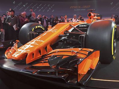 Journalists use their mobile phones to photograph McLaren's new MCL32 Formula One car at its launch in Woking, Britain, February 24, 2017. REUTER/Alan Baldwin
