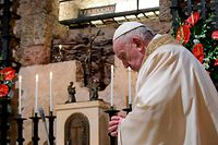 """This photo taken and handout on October 3, 2020 by the Vatican Media shows Pope Francis praying as he celebrates mass at the tomb of St. Francis in Assisi prior to signing a new encyclical on human fraternity titled """"Fratelli Tutti"""". (Photo by Handout / VATICAN MEDIA / AFP) / RESTRICTED TO EDITORIAL USE - MANDATORY CREDIT """"AFP PHOTO /VATICAN MEDIA / HANDOUT """" - NO MARKETING - NO ADVERTISING CAMPAIGNS - DISTRIBUTED AS A SERVICE TO CLIENTS"""
