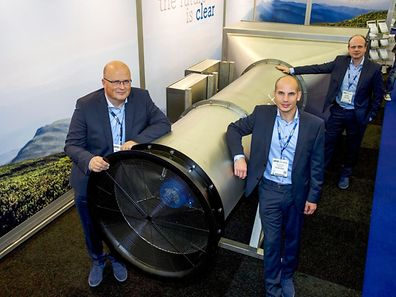Tech start-up Envinity Group shows (from L) the group's Managing Partners Peter van Wees, Simon van der Burg and Tim Petter posing next to a system created by van Wees to filter fine and ultra-fine particles from ambient air