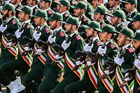 "(FILES) In this file photo taken on September 22, 2018 members of Iran's Revolutionary Guards Corps (IRGC) march during the annual military parade marking the anniversary of the outbreak of the devastating 1980-1988 war with Saddam Hussein's Iraq, in the capital Tehran. - President Donald Trump on April 8, 2019 announced the United States is designating Iran's elite military force, the Islamic Revolutionary Guard Corps, a terrorist organization. Trump said in a statement that the ""unprecedented"" move ""recognizes the reality that Iran is not only a State Sponsor of Terrorism, but that the IRGC actively participates in, finances, and promotes terrorism as a tool of statecraft."" (Photo by STRINGER / AFP)"