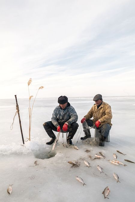 Two men managing to catch some fish in the Aral Sea. Once the world's fourth-largest lake, it is now largely a desert and the United Nations has dubbed it the worst man-made environmental disaster.