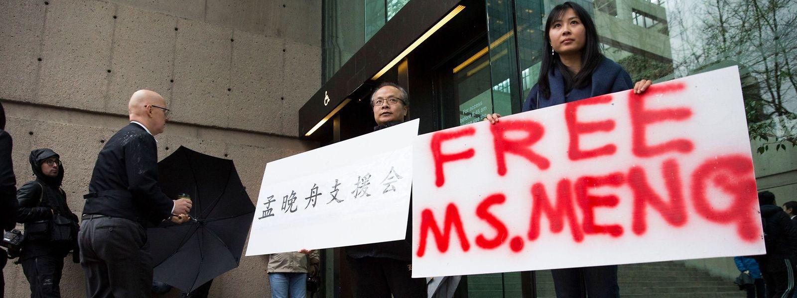 Aktivisten fordern die Freilassung von Meng Wanzhou.
