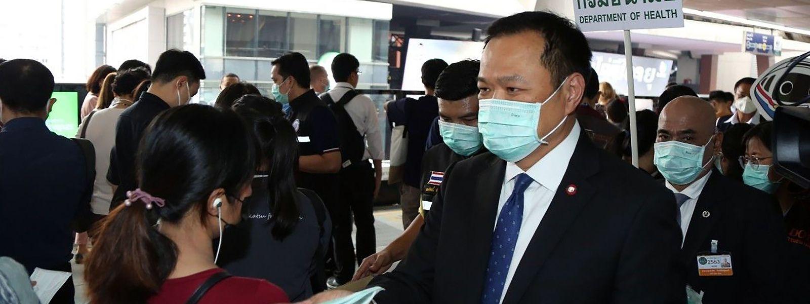 Gesichtsmasken sind ein Muss für Zuschauer in asiatischen Stadien.