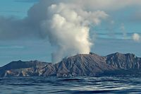 "This handout photo taken on July 23, 2019 and released to AFP courtesy of Chris Firkin on December 9, 2019 shows the volcano on New Zealand's White Island spewing steam and ash. - About 100 tourists were ""on or around"" New Zealand's White Island volcano when it erupted on December 9, 2019, and an unknown number are unaccounted for, the country's prime minister said. (Photo by Chris Firkin / Courtesy of Chris Firkin / AFP) / -----EDITORS NOTE --- RESTRICTED TO EDITORIAL USE - MANDATORY CREDIT ""AFP PHOTO / COURTESY OF CHRIS FIRKIN"" - NO MARKETING - NO ADVERTISING CAMPAIGNS - DISTRIBUTED AS A SERVICE TO CLIENTS  - NO ARCHIVES"