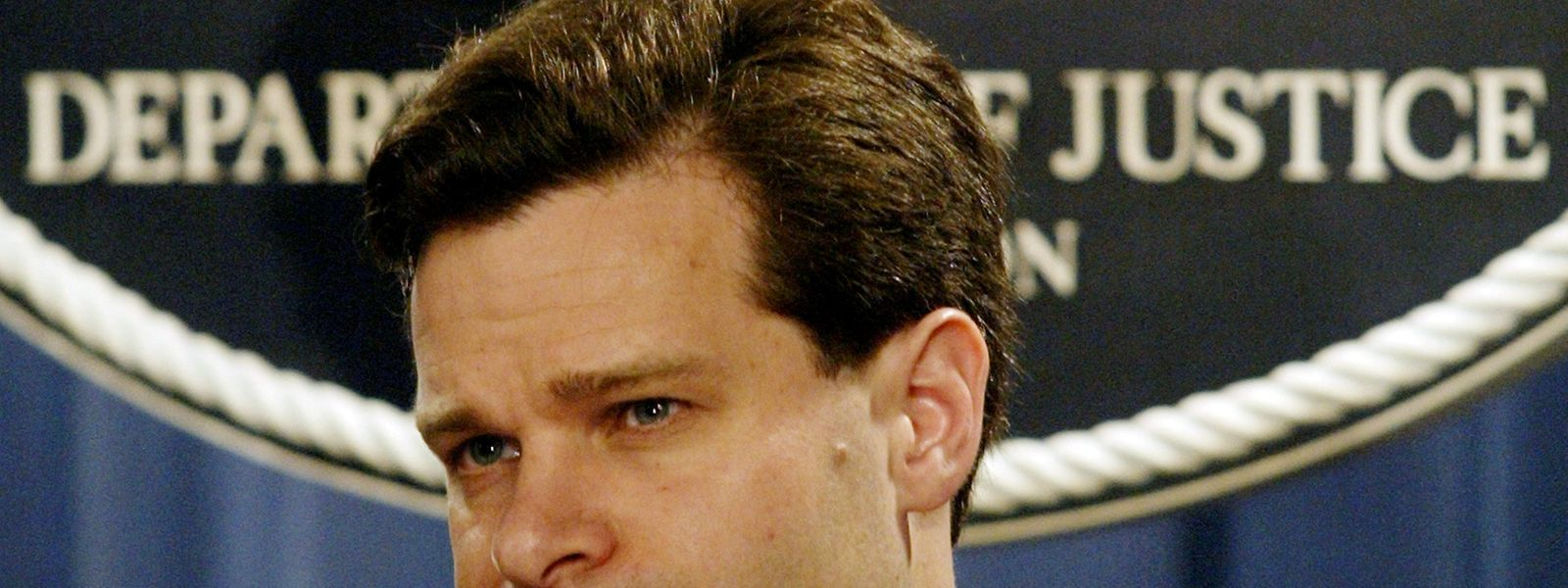 FILE PHOTO: Assistant U.S. Attorney General Christopher Wray pauses during a press conference at the Justice Department in Washington, U.S., November 4, 2003. REUTERS/Molly Riley/File Photo