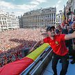 Belgium's Adnan Januzaj, Belgium's head coach Roberto Martinez and Belgium's assistant coach Thierry Henry celebrate on the balcony in front of more than 8000 supporters at the Grand Place/Grote Markt in Brussels city center, as Belgian national football team Red Devils arrive to celebrate with supporters at the balcony of the city hall after reaching the semi-finals and winning the bronze medal at the Russia 2018 World Cup, on July 15, 2018. / AFP PHOTO / BELGA / Yves HERMAN / Belgium OUT