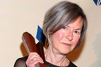 """(FILES) This file photo taken on November 19, 2014 shows Louise Gluck attending the 2014 National Book Awards in New York City. - The Nobel Literature Prize went Thursday, October 8, 2020 to American poet Louise Gluck, the jury at the Swedish Academy said. Gluck was honoured """"for her unmistakable poetic voice that with austere beauty makes individual existence universal,"""" the Academy said. (Photo by Robin Marchant / GETTY IMAGES NORTH AMERICA / AFP)"""