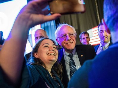 Selfie, anyone? Democratic presidential hopeful Sen. Bernie Sanders (D-VT) meeting with audience members after speaking at a New Hampshire Democratic Party celebration on February 5 in Manchester, New Hampshire