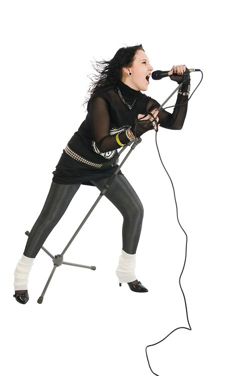 Female rock star wearing black clothes performing on white