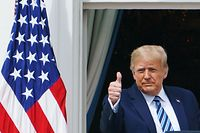 US President Donald Trump greets supporters after speaking about law and order from the South Portico of the White House in Washington, DC, on October 10, 2020. - Trump spoke publicly for the first time since testing positive for Covid-19, as he prepares a rapid return to the campaign trail just three weeks before the election. (Photo by MANDEL NGAN / AFP)