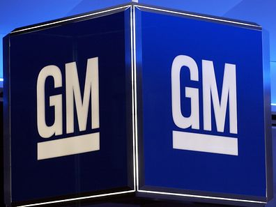 "(FILES) This file photo taken on January 11, 2005 shows the corporate logo for the General Motors Corporation during the North American International Auto Show in Detroit, Michigan.  Two US owners of General Motors diesel pickup models sued the giant automaker on May 25, 2017, claiming it had used emissions-cheating devices similar to those in Volkswagen's global ""dieselgate"" scandal.The company quickly denied the allegations. The lawsuit, filed in a Detroit federal court, came the same week that US authorities brought legal action against Fiat Chrysler, accusing the company of likewise configuring diesel-powered vehicles to deceive emissions tests, an allegation the company denies.  / AFP PHOTO / STAN HONDA"