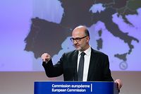 European Commissioner for Economic and Financial Affairs, Taxation and Customs Pierre Moscovici gestures as he speaks during a press conference presenting the Autumn 2019 European Economic Forecast in Brussels, on November 7, 2019. (Photo by Aris OIKONOMOU / AFP)