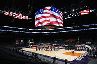 PHOENIX, ARIZONA - JANUARY 06: The Toronto Raptors and the Phoenix Suns stand arm-in-arm during the national anthem before the NBA game at Phoenix Suns Arena on January 06, 2021 in Phoenix, Arizona. NOTE TO USER: User expressly acknowledges and agrees that, by downloading and or using this photograph, User is consenting to the terms and conditions of the Getty Images License Agreement.   Christian Petersen/Getty Images/AFP == FOR NEWSPAPERS, INTERNET, TELCOS & TELEVISION USE ONLY ==