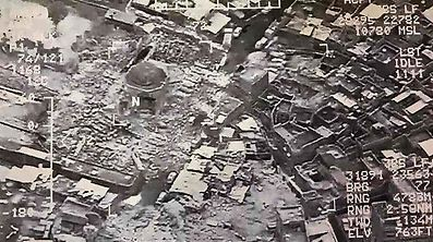 "(FILES) This aerial view taken on June 21, 2017 and provided by Iraq's Joint Operation Command reportedly shows destruction inside Mosul's Nuri mosque compound. Jihadists blew up Mosul's iconic leaning minaret and the adjacent Nuri mosque where their leader Abu Bakr al-Baghdadi declared a ""caliphate"" in his only public appearance in 2014, an Iraqi commander said. The Islamic State group swiftly issued a statement via its Amaq propaganda agency blaming a US strike for the destruction of the Nuri mosque and the historic leaning Hadba minaret in its vicinity.  / AFP PHOTO / Joint Operation Command / HO"