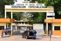 Picture of the entrance of the National Police headquarters in Asuncion, where Brazilian retired football player Ronaldinho and his brother Roberto Assis are being held after being arrested for their irregular entry to the country, taken on March 9, 2020. - Former Brazilian football star Ronaldinho and his brother have been detained in Paraguay after allegedly using fake passports to enter the South American country, authorities said Wednesday. (Photo by NORBERTO DUARTE / AFP)