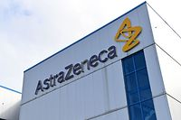 "(FILES) In this file photo taken on July 21, 2020 a general view is pictured of the offices of British-Swedish multinational pharmaceutical and biopharmaceutical company AstraZeneca PLC in Macclesfield, Cheshire. - Pharmaceutical company AstraZeneca said on September 8, 2020 that it had ""voluntarily paused"" a randomized clinical trial of its coronavirus vaccine in what it called a routine action after a volunteer developed an unexplained illness. (Photo by Paul ELLIS / AFP)"