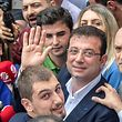 Istanbul mayoral candidate of the main opposition Republican People's Party (CHP) Ekrem Imamoglu waves as he leaves the polling station with his Dilek Imamoglu (behind) and their son Semih ?mamoglu (foreground), on June 23, 2019 in Istanbul. - Istanbul went back to the polls on June 23, 2019 in a re-run of the mayoral election that has become a test of Turkish democracy as well as Turkish President's continued popularity at a time of economic trouble. (Photo by Bulent Kilic / AFP)