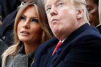 US First Lady Melania Trump (L) and US President Donald Trump attend a ceremony at the Arc de Triomphe in Paris on November 11, 2018 as part of commemorations marking the 100th anniversary of the 11 November 1918 armistice, ending World War I. (Photo by BENOIT TESSIER / POOL / AFP)