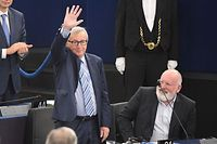 European Commission President Jean-Claude Juncker (L) waves after a speech at the European Parliament on October 22, 2019, in Strasbourg, eastern France. (Photo by FREDERICK FLORIN / AFP)