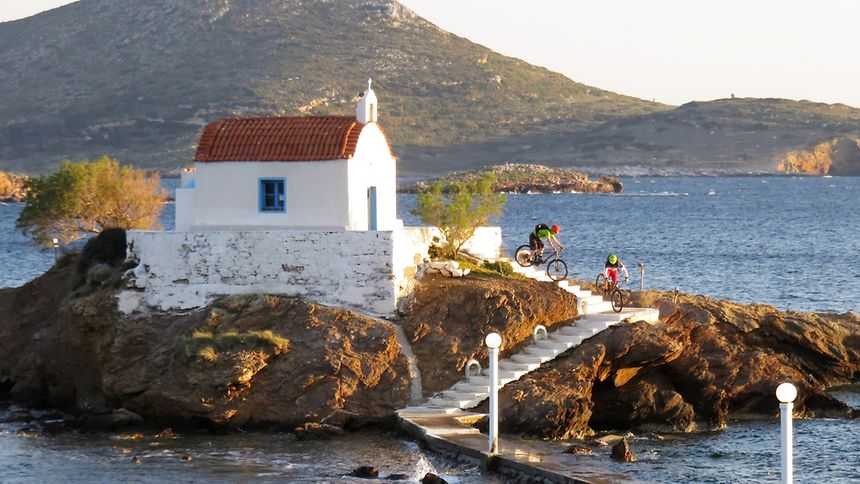 De Fränz (second rider) exiting a small chapel on the Greek island of Leros.