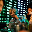 In this picture taken on January 28, 2017, a male host shares a lighter moment with a female customer at a host club in the Kabukicho red-light district in Tokyo. Host clubs are a 10 billion USD industry in Japan with some 800 venues nationwide. Around 260 of those are located in Tokyo, most squeezed into Kabukicho's narrow streets where flickering neon signs display the air-brushed faces of hosts outside clubs with names such as Romeo, Gatsby and Avalon.   / AFP PHOTO / BEHROUZ MEHRI / TO GO WITH Japan-culture-lifestyle-hosts,FEATURE by Alastair HIMMER