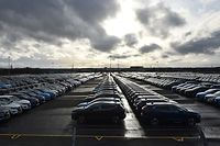 (FILES) In this file photo taken on March 16, 2019 Nissan cars are pictured, parked in a lot at its' Sunderland plant in north east England on March 16, 2019. - Car giant Nissan announced a halt in production on March 17, 2020 at its Sunderland factory because of falling demand amid the coronavirus outbreak. (Photo by ANDY BUCHANAN / AFP)