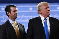 "(FILES) In this file photo taken on September 26, 2016, Republican presidential nominee Donald Trump (R) stands with his son  Donald Trump Jr. after the first presidential debate at Hofstra University in Hempstead, New York. President Trump denied on July 27, 2018, knowing about a 2016 meeting between top members of his election campaign team and a Russian lawyer, disputing reported claims by his former attorney, Michael Cohen. ""I did NOT know of the meeting with my son, Don jr,"" Trump said in a tweet. / AFP PHOTO / Jewel SAMAD"