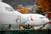 (FILES) In this file photo taken on November 10, 2020 Boeing 737 MAX airliners with American Airlines markings are pictured on the ramp at Renton Airport adjacent to the Boeing Renton Factory in Renton, Washington. - US prosecutors hit Boeing with a $2.5 billion fine to settle charges the company defrauded regulators over the 737 MAX, the Justice Department announced January 7, 2021. (Photo by Jason Redmond / AFP)