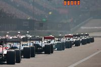 Cars line up on the grid for the start of the Chinese Formula One Grand Prix in Shanghai, China, Sunday, April 14, 2013. (AP Photo/Ng Han Guan)