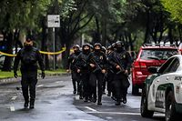 Police officers are deployed after Mexico City's Public Security Secretary Omar Garcia Harfuch was wounded in an attack in Mexico City, on June 26, 2020. (Photo by PEDRO PARDO / AFP)
