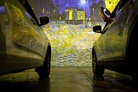 People sit in their cars as they experience a drive-in immersive Vincent Van Gogh art exhibit in Toronto, Ontario, Canada, on July 3, 2020. - Amid the coronavirus pandemic, many events are having to rethink their programming and innovate in order to comply with social distancing measures. (Photo by Cole BURSTON / AFP)