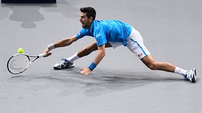 Serbia's Novak Djokovic returns the ball to Luxembourg's Gilles Muller during their second round tennis match at the ATP World Tour Masters 1000 indoor tournament.