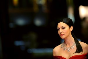 """(FILES) This file photo taken on May 16, 2009 shows Italian actress Monica Bellucci posing while arriving for the screening of the movie """"Ne Te Retourne Pas"""" (Don't Look Back) out of competition at the 62nd Cannes Film Festival. / AFP PHOTO / ANNE-CHRISTINE POUJOULAT"""