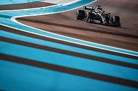 (FILES) In this file photo taken on December 1, 2019 Mercedes' British driver Lewis Hamilton steers his car at the Yas Marina Circuit in Abu Dhabi, during the final race of the Formula One Grand Prix season. - Lewis Hamilton will launch his bid to equal Michael Schumacher's total of seven world championships and break a clutch of other F1 records when the Australian Grand Prix opens the 2020 season on March 15, 2020. (Photo by ANDREJ ISAKOVIC / AFP)