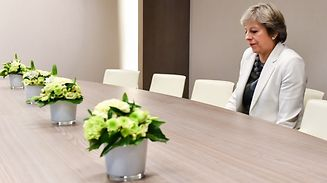 TOPSHOT - British Prime Minister Theresa May takes a seat as she arrives for a bilateral meeting with European Council President Donald Tusk during an EU summit in Brussels on October 20, 2017.   The EU is expected to say that they will start internal preparatory work on a post-Brexit transition period and a future trade deal with Britain. / AFP PHOTO / POOL / Geert Vanden Wijngaert
