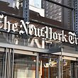 (FILES) In this file photo taken on September 06, 2018 (FILES) In this file photo taken on September 6, 2018 The New York Times building is seen  in New York. - The New York Times has announced it will no longer include daily political cartoons in its international edition, weeks after apologising for publishing a caricature of Israeli Prime Minister Benjamin Netanyahu deemed anti-Semitic. The cartoon, published in April 2019, depicted Netanyahu as a guide dog wearing a Star of David collar and leading a blind Donald Trump -- who was wearing a kippah, or a Jewish skullcap.The decision will come into effect on July 1,2019 Bennet said in a June 10, 2019 statement. (Photo by ANGELA WEISS / AFP)