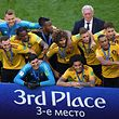 Belgium's players pose with their medals after their Russia 2018 World Cup play-off for third place football match between Belgium and England at the Saint Petersburg Stadium in Saint Petersburg on July 14, 2018. Belgium achieved their best World Cup finish as goals from Thomas Meunier and Eden Hazard secured a 2-0 victory over England in Saturday's third-place playoff in Saint Petersburg. / AFP PHOTO / OLGA MALTSEVA / RESTRICTED TO EDITORIAL USE - NO MOBILE PUSH ALERTS/DOWNLOADS