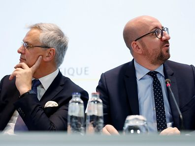 Belgian Prime Minister Charles Michel holds a joint news conference with Deputy Prime Minister Kris Peeters (L) in Brussels, Belgium, October 15, 2016.