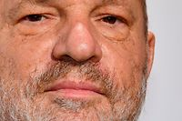 "(FILES) This file photo taken on May 23, 2017 shows US film producer Harvey Weinstein attending the De Grisogono Party on the sidelines of the 70th Cannes Film Festival in Antibes, France.  The state of New York filed a lawsuit against Harvey Weinstein, his brother and their eponymous production company on February 11, 2018, for ""egregious violations"" of civil rights, human rights and business laws. / AFP PHOTO / Yann COATSALIOU"