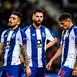 Porto's Brazilian defenders Alex Telles (L) and Felipe (C), and Brazilian forward Tiquinho Soares (R) react to their defeat at the end of the UEFA Champions League quarter-final second leg football match between FC Porto and Liverpool at the Dragao stadium in Porto on April 17, 2019. (Photo by PATRICIA DE MELO MOREIRA / AFP)