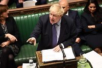 """A handout picture released by the UK Parliament shows Britain's Prime Minister Boris Johnson (C) speaking in the House of Commons in London on October 22, 2019, speaking at the opening of the debate into the Brexit withdrawal agreement bill in the House of Commons in London on October 22, 2019. - British Prime Minister Boris Johnson threatened Tuesday to abandon ratifying his Brexit deal and instead seek an early election if MPs defy his timetable to get the agreement passed in time to leave the EU on October 31. The Conservative leader was speaking ahead of two crucial votes in the House of Commons that will determine if Johnson can fulfil his """"do or die"""" promise to deliver Brexit at the end of next week. (Photo by JESSICA TAYLOR / various sources / AFP) / RESTRICTED TO EDITORIAL USE - MANDATORY CREDIT """" AFP PHOTO / UK PARLIAMENT / JESSICA TAYLOR  """" - NO USE FOR ENTERTAINMENT, SATIRICAL, MARKETING OR ADVERTISING CAMPAIGNS - EDITORS NOTE THE IMAGE HAS BEEN DIGITALLY ALTERED AT SOURCE TO OBSCURE VISIBLE DOCUMENTS /"""