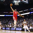 OAKLAND, CA - OCTOBER 17: Eric Gordon #10 of the Houston Rockets dunks the ball against the Golden State Warriors during their NBA game at ORACLE Arena on October 17, 2017 in Oakland, California. NOTE TO USER: User expressly acknowledges and agrees that, by downloading and or using this photograph, User is consenting to the terms and conditions of the Getty Images License Agreement.   Ezra Shaw/Getty Images/AFP == FOR NEWSPAPERS, INTERNET, TELCOS & TELEVISION USE ONLY ==