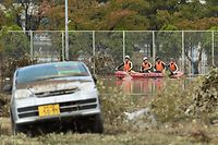 Emergency personnel paddle across floodwaters during search and rescue operations in the aftermath of Typhoon Hagibis in Nagano on October 14, 2019. - Tens of thousands of rescue workers were searching on October 14 for survivors of powerful Typhoon Hagibis, two days after the storm slammed into Japan, killing at least 35 people. (Photo by Kazuhiro NOGI / AFP)