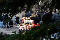 """Candles and flowers to commemorate the victims are placed close to the Porta Nigra landmark in Trier, southwestern Germany, on December 2, 2020, one day after a car drove into pedestrians. - A baby was among five people killed when a car tore through a pedestrian shopping street in Trier on Tuesday, December1, 2020. A prosecutor said that the driver, a 51-year-old Trier native, appeared to be suffering from """"psychiatric problems"""" and had been under the influence of alcohol during the incident, in which 14 other people were hurt. (Photo by Jean-Christophe VERHAEGEN / AFP)"""