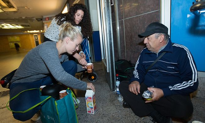 Distributing food to the homeless in Luxembourg
