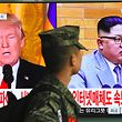 A South Korean soldier walks past a television screen showing pictures of US President Donald Trump (L) and North Korean leader Kim Jong Un at a railway station in Seoul on March 9, 2018.  US President Donald Trump agreed on March 8 to a historic first meeting with North Korean leader Kim Jong Un in a stunning development in America's high-stakes nuclear standoff with North Korea. / AFP PHOTO / Jung Yeon-je