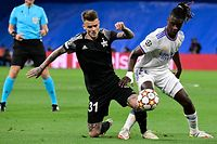 Sheriff's  midfielder Sebastien Thill vies with Real Madrid's French midfielder Eduardo Camavinga (R) during the UEFA Champions League first round group D footbal match between Real Madrid and Sheriff Tiraspol at the Santiago Bernabeu stadium in Madrid, on September 28, 2021. (Photo by JAVIER SORIANO / AFP)